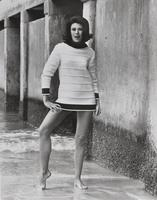 Woman wearing knit sweater made with Orlon