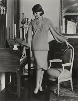 Woman modeling knit two-piece dress made with Orlon.