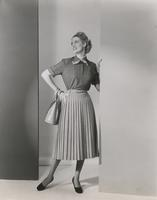 Woman wearing skirt and blouse of Orlon, wool, and flannel
