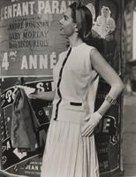 Woman wearing cardigan and skirt made with Orlon