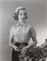 Woman wearing shantung blouse made of Orlon and nylon