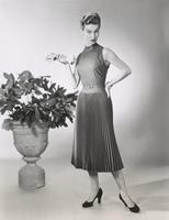 Woman wearing pleated dress made of Orlon and wool