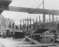 Workers on frames during construction of Pennsylvania Railroad Barge