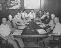 L. A. Grettum signing agreement with C.I.O. officials and men