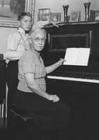 Mary Emma Seal and her grandniece, Eleanor Seal, at the piano