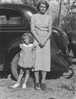 Blanche E. McDaniel Seal and daughter, Janice, standing with family car