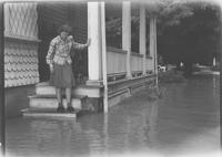 Anna Seal Schlosser on steps of home after flood (Chadds Ford, Pa.)