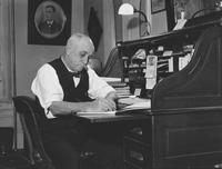 Howard Ellsworth Seal, Sr. seated at desk