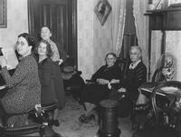 Group seated at home of Letitia Talley