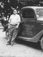 Howard Ellsworth Seal, Sr. standing next to his son's company truck