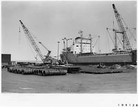 Ships unloading imported steel at Cleveland, Ohio Municipal Docks