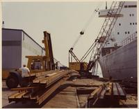 Structural steel being loaded onboard a ship