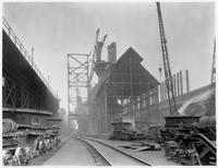 Blast furnaces showing cast house and erection of steel at top works, Bethlehem Steel Company (Lackawanna, N.Y.)