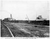 Crane loading scrap into boat, J. Kovinsky and Sons, Ltd. (East Windsor, Ontario, Canada)