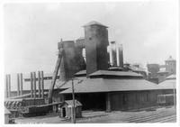 Iron shell open top blast furnaces with charging elevator