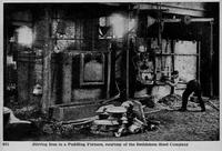 Manipulating near-molten iron and slag sponge in furnace at puddling mill, Bethlehem Steel Company