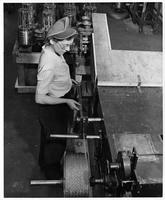 Operating a crimping machine, South Works, American Steel & Wire Company (Worcester, Mass.)