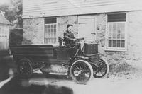 Albert Roberts at steering wheel of the first truck owned by Joseph Bancroft & Sons Co.