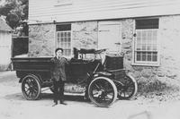 Albert Roberts next to the first truck owned by Joseph Bancroft & Sons Co.