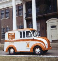 Wawa Dairy Farms home delivery truck outside main entrance of milk processing plant