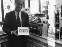 President of Wawa Inc., Richard (Dick) Wood, with commemorative framed one-dollar bill at opening of the 200th Wawa store (Souderton , Pa.)