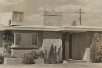 Front of house showing air conditioner, door, and chimney in Tucson, Arizona