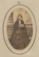 Unidentified woman wearing coat and muff