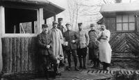 Soldiers and doctors with dog outside French military hospital