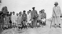 Alice Belin du Pont with group of children during trip to Spain