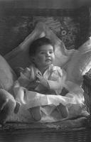 Unidentified Clarke family toddler sitting on chair