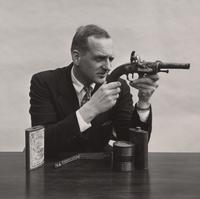 E. I. du Pont, III, with Pistol