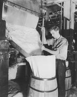 Packing synthetic Camphor from flaking machine at the Deepwater Point NJ plant of E.I. du Pont Nemours & Company.