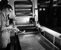 Checking cord tension in Textile Research Laboratory at Chestnut Run