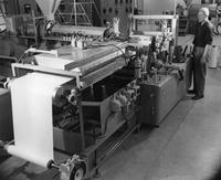 Modern extruder laminator in the Plastic Department's Technical Service Laboratory