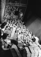 Final inspection of sponges at Buffalo, New York, plant