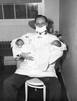 Dr. L. Hanville with the first twins born on the project at Camp Hanford Hospital