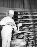 Cook at Hanford Engineering Works making many hundreds of pies for employees