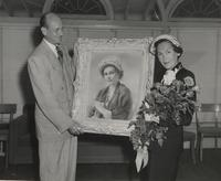 Maureen O'Sullivan being presented with a painting of herself used for Avon advertising