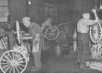 Rubbing wheels with linseed oil, from 'The Wooden Wheel Industry'