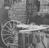 Applying rim to the wheel, from 'The Wooden Wheel Industry'