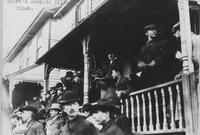 Charles W. Matheson standing on porch during 1907 Giants Despair Hillclimb