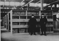 Henry Palmer and his attorney in the stock room of the Matheson plant at Wilkes-Barre