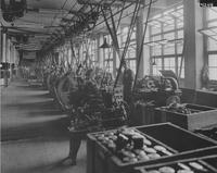 Belt-driven machinery in wheel factory