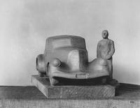 Model car with clay person, front view