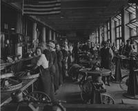 Workers on line in wheel factory