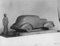 Model car with clay person, side rear view