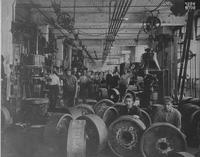 Factory interior with employees