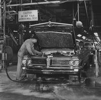 Automobile assembly, preparing car for roll test
