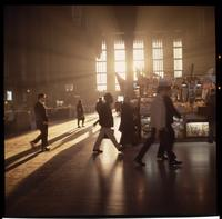 Passengers walking through 30th Street station