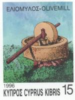 Postage stamp from Cyprus depicting olive crushing mill